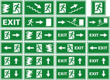 Vector symbol set - emergency exit sign - fire alarm plate - person escaping flames through door. A collection of different variations of emergency exit signs / Stock Photography