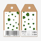 Vector tags design on both sides, cardboard sale labels with barcode. St Patricks day background, green clovers Royalty Free Stock Photography