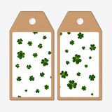 Vector tags design on both sides, cardboard sale labels. St Patricks day vector background, green clovers Stock Photos
