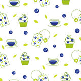 Vector tea bag blueberry seamless pattern. Vector tea bag blueberry pattern. Blue tea cup and cup cakes with berries white seamless background for package Stock Photography