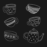Vector tea set. A collection of stylized cups and teapots. Coffee. Linear Art. Hot drinks. Drawing by hand. Royalty Free Stock Photos