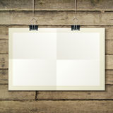 Vector template of a paper sheet -poster, picture. Vector template of a paper sheet, poster, picture frame, on wooden background, vector illustration eps 10 Royalty Free Stock Photos