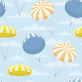 Vector texture with yellow, blue, orange parachutes and clouds Stock Photo