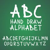 Vector textured rough abc alphabet hand drawn letters written with a brush on blackboard or chalkboard.  Stock Illustration