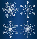 Vector textured snowflakes Stock Images