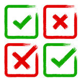 Vector tick cross grunge brush stroke set for no, yes, OK, X. Vector tick and cross brush stroke sign set. Green and red OK, X vote option check mark icons Royalty Free Stock Images