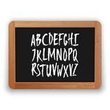 Vector A to Z Uppercase Letters on a Blackboard. Vector A to Z uppercase letters. Hand written latin alphabet on a blackboard. Isolated on white background stock illustration