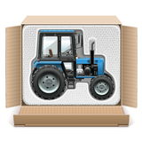 Vector Toy Tractor in Box Royalty Free Stock Images
