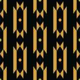 Vector trendy black and gold seamless decorative ethnic pattern. Stock Photos
