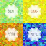 Vector triangular backgrounds on the theme of the four seasons of the year. Spring, Summer, Autumn and Winter with a vignette and the inscription of the season Royalty Free Stock Photography