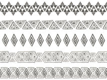 Vector tribal seamless brushes Stock Images