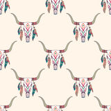 Vector tribal seamless pattern with bull skull and ethnic feathers. Stock Photos