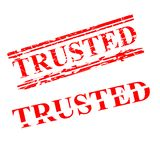 Trusted, 2 style streak red rubber stamp, isolated on white stock photos