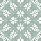 Vector uitstekende ontwerpkerstmis stileerde witte Sneeuwvlokken op een groene Achtergrond Naadloos patroon Stock Illustratie