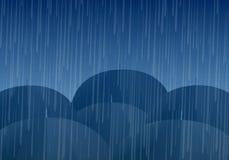 Vector umbrellas and rain drops Stock Images
