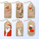 Vector una raccolta di sei etichette sveglie del regalo di natale con Santa, il ciuffolotto, la lepre e la renna rossa Rudolph de Fotografia Stock Libera da Diritti