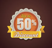 Vector up to 50% discount badge. Detailed icon representing fabric badge with embroidered Discount text Royalty Free Stock Photo