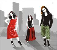 Vector urban women. Three young women with urban landscape Royalty Free Stock Image