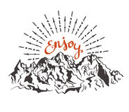Vector vintage card with mountains, sunburst and inspirational phrase Enjoy. Royalty Free Stock Photography