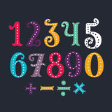 Vector of vintage carnival font and alphabet. Vector cartoon funny set of vintage hand drawn carnival colorful numbers on dark background Stock Photography