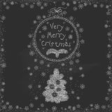 Vector vintage Christmas doodles. Seasonal hand drawn cartoon on black chalk dirty board Royalty Free Stock Photography