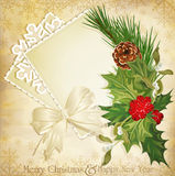 Vector vintage christmas holly and ribbon royalty free stock images