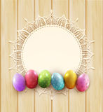 Vector vintage circle of lace and easter eggs on the wooden background Royalty Free Stock Image