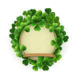 Vector vintage circle with space for text in a frame of shamrock Stock Image