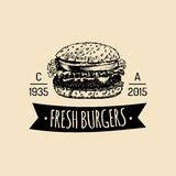 Vector vintage fast food logo. Retro hand drawn burger label. Hipster sandwich sign. Bistro icon. Street eatery emblem. Royalty Free Stock Images