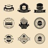 Vector vintage fast food logo set. Retro eating signs collection. Burger, hamburger, hot dog, frankfurter emblems. Royalty Free Stock Photo
