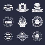 Vector vintage fast food logo set. Retro eating signs collection. Burger, hamburger, hot dog, frankfurter emblems. Stock Photos