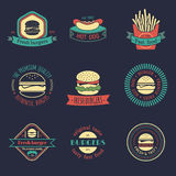 Vector vintage fast food logos set. Burgers, hot dogs, sandwiches illustrations. Snack bar, street restaurant icons. Vector vintage fast food logos set. Burgers Stock Photography
