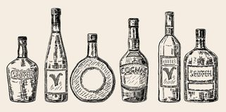 Vector vintage hand drawn sketch style alcohol bottles set. Vector vintage hand drawn illustration of bottles for alcoholic beverages, drinks. Wine, brandy Stock Images