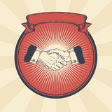 Vector vintage illustration of badge, sticker, sign with a male hands making a handshake. Print, template, design element Royalty Free Stock Image
