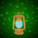 Vector vintage kerosene lamp on a green background with snowflak Stock Image