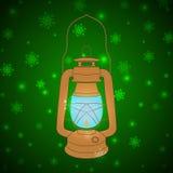 Vector vintage kerosene lamp on a green background with snowflak Stock Image