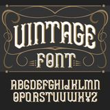 Vector vintage label font.  . Vector vintage label font on a dark backround. Label font Royalty Free Stock Images