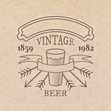 Vector vintage label. Pressed out on craft paper, beverages emblem - beer glass with place for text ribbon an tag Stock Photos