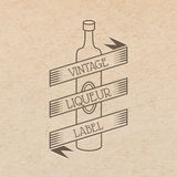 Vector vintage label. Pressed out on craft paper, beverages emblem - wine bottle with place for text ribbon Stock Image