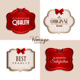 Vector vintage labels with red ribbons. Vintage labels with red ribbons Royalty Free Stock Images