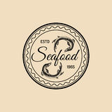 Vector vintage seafood logo. Marine products emblem. Hand sketched sturgeons illustration. Fish restaurant, market icon. Vector vintage seafood logo. Retro Royalty Free Stock Images