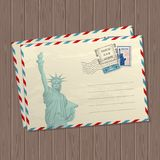 Vector vintage style letters with the statue of liberty, marks and stamps of usa and place for text on wooden texture vector illustration