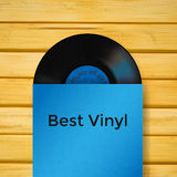 Vector vinyl record in cover on wooden background. Vector vinyl record in cover on wooden royalty free illustration