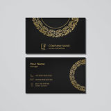 Vector visit card template with gold round frame and floral ornament Royalty Free Stock Image