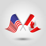 Vector waving triangle two crossed american and canadian  flags on slanted silver pole - icon united states of america and Stock Photography