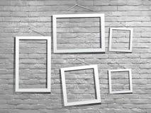 Vector Weißspott herauf Fotorahmen mit Backsteinmauer Stockbilder