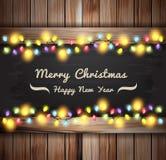 Vector Weihnachtslichter auf hölzernen Brettern und Tafel Stockfotos