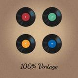 Vector Weinleseart mit vier Vinylaufzeichnungen auf beige strukturiertem Hintergrund Lizenzfreie Stockfotos