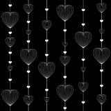 Vector of white heart shaped designs on black background Stock Photo