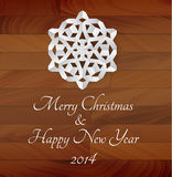 Vector white paper snowflake on a wooden background. Rustical christmas card Stock Image
